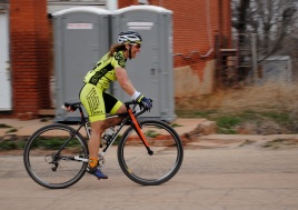 A cyclist arrives at the halfway checkpoint in Carney, Okla., during the first Land Run 100 in 2013.