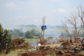 A wider view of the countryside and the wreckage from the Carney tornado.